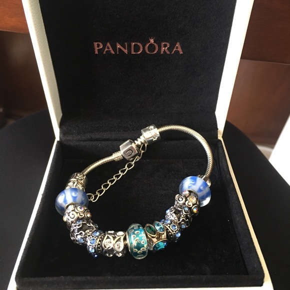 d842410def6 Baby blue pandora bracelet with 11 charms!